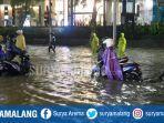banjir-surabaya-mayken-sungkono.jpg