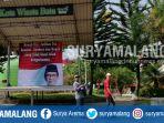 banner-dukungan-untuk-eddy-rumpoko-di-panggung-alun-alun-kota-batu_20180427_190053.jpg