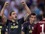 bek-juventus-leonardo-bonucci-merayakan-kemenangan-timnya-atas-valencia_20180920_164606.jpg
