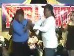 beredar-video-viral-seorang-pembawa-acara-atau-mc-dipukul-oleh-dua-pria-di-panggung-dangdut.jpg