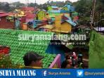 breaking-news-hujan-deras-tembok-rumah-di-kampung-warna-warni-kota-malang-ambrol_20161026_154906.jpg
