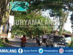 dahan-pohon-yang-menutupi-rambu-penunjuk-jalan-di-kepanjen-kabupaten-malang_20180227_174404.jpg