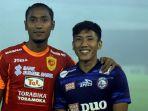 dua-pemain-asal-malang-sandy-firmansyah-kiri-dan-ahmad-bustomi_20180101_194630.jpg