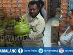 eddy-mangun-mengecek-stok-elpiji-3-kilogram-di-salah_20180511_161708.jpg