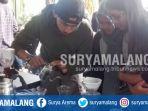 festival-kopi-internasional-di-hutan-pinus-coban-talun-kota-batu_20171001_205130.jpg