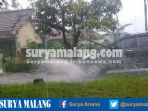 hujan-deras-dan-pohon-tumbang-di-kawasan-lesanpuro-kota-malang_20170113_141726.jpg