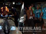 ikan-lumba-luma-yang-terdampar-di-pantai-serang-kecamatan-panggungrejo-kabupaten-blitar.jpg