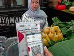 ilustrasi-pembayaran-menggunakan-pembayaran-non-tunai-quick-respon-indonesia-standar-qris.jpg