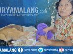 indrawati-sedang-memberi-makan-kucing-di-pasar-sleko-madiun_20180726_141843.jpg
