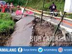 jalan-penghubung-tulungagung-ponorogo-ambrol-di-desa-kradinan-kecamatan-pagerwojo.jpg