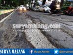 jalan-rusak-di-kota-malang-akibat-hujan_20170111_224610.jpg