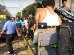 kecelakaan-mobil-ditabrak-kereta-api-di-perlintasan-al-fitroh-dekat-stasiun-batu-ceper-tangerang_20180618_111917.jpg