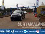 kendaraan-di-pintu-masuk-tol-malang-pandaan-mapan-seksi-3-di-sumberwuni-lawang-kabupaten-malang_20180609_150126.jpg