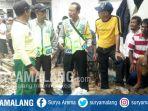 kepolisian-dan-pmi-saat-mengevakuasi-korban-yang-tercebur-sumur-di-poncokusumo-malang_20180216_194436.jpg