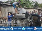 kondisi-mobil-yang-ditabrak-kereta-api-ka-di-pagesangan-surabaya_20181021_143137.jpg