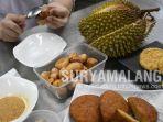 mahasiswa-ottimmo-international-surabaya-enrico-kreshna-membuat-donat-dari-limbah-buah-durian.jpg