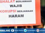 malang-corruption-watch-mcw-demontrasi-di-jalan-tugu-kota-malang_20171208_182621.jpg