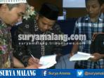 mengenali-jejak-pahlawan-santri-buku-karya-munawir-azis-dibedah-di-universitas-negeri-malang_20161006_012011.jpg