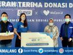 menteri-sosial-tri-rismaharini-menerima-donasi.jpg
