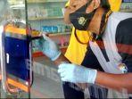 olah-tkp-pencurian-apotek-kimia-farma-jalan-trunojoyo-kelurahan-pandean-taman-kota-madiun.jpg