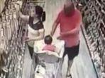 orang-tua-taruh-anak-di-troli-saat-belanja-di-supermarket_20170417_180527.jpg
