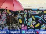 para-seniman-graffiti-saat-beraksi-di-favehotel-sidoarjo-sabtu-2072019.jpg
