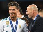 pelatih-real-madrid-zinedine-zidane-melakukan-selebrasi-bersama-cristiano-ronaldo_20180531_204135.jpg