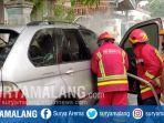 pemadaman-kebakaran-mobil-bmw-x5-di-jalan-bendungan-bening-kota-malang.jpg