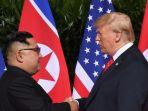 pemimpin-korea-utara-kim-jong-un-dan-presiden-amerika-serikat-donald-trump-singapura_20180612_135108.jpg