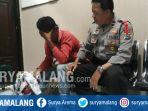 pemuda-asal-kediri-agung-saputro-setelah-ditangkap-anggota-polsek-manyar-gresik_20180322_140420.jpg