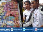penipuan-dengan-penggadaan-uang-fakrul-akbar-dan-barang-bukti-berupa-uang-main_20181018_151016.jpg