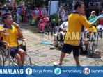 penyandang-disabilitas-bernyanyi-usai-jalan-sehat-di-ypac-kota-malang.jpg