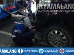 petugas-menderek-kendaraan-yang-parkir-sembarangan-di-jalan-dharmawangsa-surabaya_20181024_113710.jpg