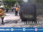 petugas-sedang-memadamkan-api-yang-membakar-mobil-boks-di-jalan-jemursari-surabaya_20181106_145811.jpg