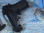 pistol-mainan-dan-10-peluru-aktif-di-rumah-kontrakan-desa-karangsoko-kabupaten-trenggalek.jpg