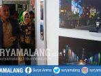 pjs-wali-kota-malang-wahid-wahyudi-melihat-karya-fotografi-dalam-festival-fotografi_20180408_194011.jpg