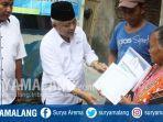 plt-bupati-malang-m-sanusi-memberi-bantuan-bedah-rumah-saat-gelar-gema-desa-di-kecamatan-pagak.jpg