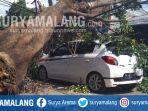 pohon-beringin-tumbang-dan-menimpa-mobil-di-jl-galunggung-kota-malang-rabu-2352018_20180523_143525.jpg
