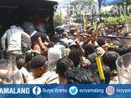 polisi-membubarkan-aksi-aliansi-mahasiswa-papua-amp-di-jalan-kahuripan-kota-malang-1.jpg