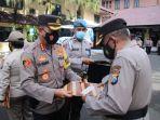 polresta-malang-kota-memberi-piagam-penghargaan-bagi-35-polisi-berprestasi.jpg