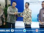 presdir-bca-syariah-john-kosasi-dan-kepala-kantor-wilayah-bank-indonesia-malang-dudi-herawadi_20171214_184928.jpg