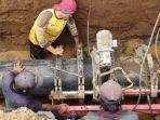 proses-perbaikan-pipa-pdam-kota-malang-yang-bocor-di-pulungdowo-kabupaten-malang.jpg