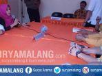 prosesi-pendaftaran-bacaleg-oleh-parpol-ke-kpu-kabupaten-malang-pada-selasa-1772018_20180718_181125.jpg