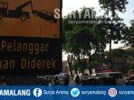 rambu-bergambar-derek-terpasang-di-jalan-pemuda-surabaya_20181101_103931.jpg