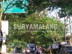 rambu-yang-tertutup-dahan-pohon-di-kepanjen-kabupaten-malang_20180227_173444.jpg