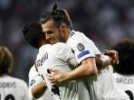 real-madrid-gareth-bale-selebrasi-gol-vs-as-roma_20180920_130429.jpg