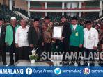 rektor-unisma-prof-dr-masykuri-msi-menerima-penghargaan-dari-museum-rekor-indonesia_20180905_185236.jpg