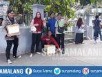 relawan-ampu-yang-menjaring-donasi-di-empat-titik-di-kampus-uin-maulana-malik-ibrahim.jpg
