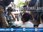 satpol-pp-surabaya-menangkap-pelajar-yang-membolos-dan-cangkruk-di-warung-kopi_20181022_131247.jpg