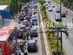 sejumlah-kendaraan-mulai-keluar-dari-kota-malang-pada-h4-lebaran-minggu-962019.jpg